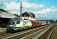 am Foto: 1116.142 CAT-Lokomotive vor Intercity-Zug (Pusarnitz)