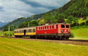 am Foto: 1041.005 mit Post-Wagen (St. Georgen)